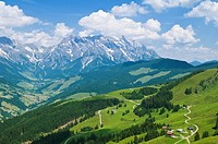 Green alpine hillside and distant peak of Hochkönig 2,941m in the Northern limestone alps, Austria