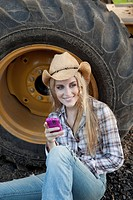 Portrait of woman on farm with cellphone