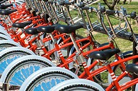 many red bikes parked for public use, Saragossa, Spain