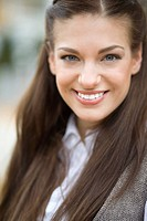 Portrait of young happy woman outdoors