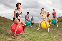 Young people bouncing on hoppity horses (thumbnail)