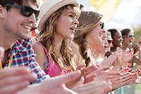 Teenage girls clapping at festival (thumbnail)