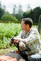 Farmer sitting on tractor