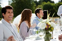 Happy man at outdoor dinner party