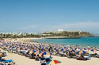Parasols on Puerto del Carmen beach , Lanzarote