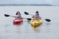 Couple and daughters kayaking