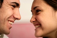 Couple smiling at each other                                                                                                                          ...