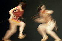 Female fencers in action