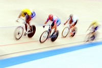 Cyclists racing on the velodrome track                                                                                                                ...
