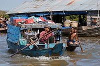 Merchant boat in the Vietnamese floating village of Chong Kneas on lake Tonle Sap _ Siem Reap, Cambodia