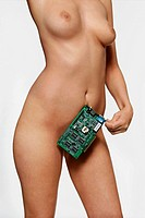 Naked woman holding circuit board