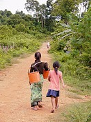 CAMBODIA. Mother and daughter walking to Katot village, inhabited by the Prov tribal group, Stung Treng district