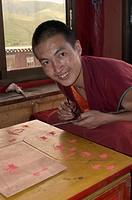 Buddhist monk practices sand mandala painting in Dhokham Garther Monastery _ Kham, Sichuan Province, China, Tibet