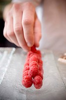 Hand Stacking Raspberries
