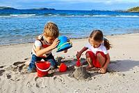 children playing on sandy beach, Sutherland, Scotland