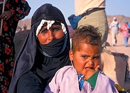 Covered Bedouin woman with child, Egypt