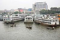 Cruise boats and steamer in Burigunga Buri Gunga River , Sadarghat Boat terminal , Dhaka , Bangladesh