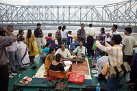People enjoying music in boat , Boating in River Hooghly , View of Howrah Bridge now Rabindra Setu , Calcutta Kolkata , West Bengal , IndiaHowrah Br...