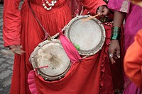 Gondhali from Solapur District playing drums during the Procession of goddess Amba devi from Kalwa to Tembhi Naka , Thane , Maharashtra , India