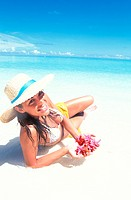 Maldives, Ari Atoll. White Sands Island. Woman on beach