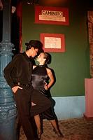 Argentina, Buenos Aires, La Boca quarter, couple performing Tango