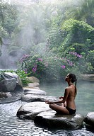 Hot Spring Pool at the Brilliant Resort & Spa in Kunming, Yunnan Province, China. Woman doing yoga
