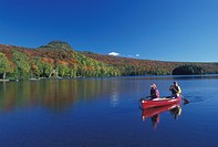 canoe, canoeing, Vermont, VT, Mother and daughter paddle a red canoe on Long Pond in Westmore in the fall.