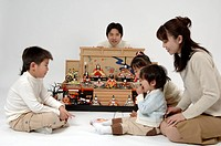 Family enjoying doll festival