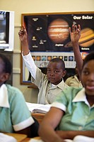 Schoolboy with his hand raised during classtime, KwaZulu Natal Province, South Africa