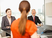 Business people laughing in conference room