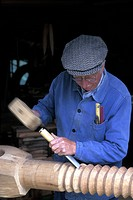 Europe, France, Normandy, Goderville, Craftsman with wooden mallet