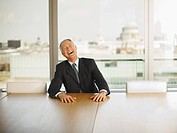 Businessman laughing in conference room