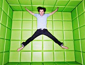 Man jumping in padded room