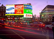 Lights of cars and neon signs in Picadilly Circus, London, England.