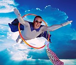 Man flying through a hoola_hoop digital composite