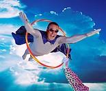 Man flying through a hoola_hoop digital composite