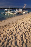Beach in Philippines with traditional banka boats