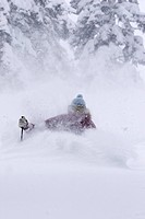 A woman skiing deep powder snow in a storm Alpine Meadows in Lake Tahoe, California