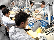 Technicians in wristwatch factory