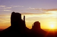 USA, Arizona, Monument Valley Navajo Tribal Park, sunrise over the Left and Right Mittens