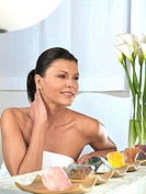 Woman at spa in front of crystals crystal therapy