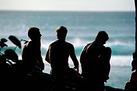 Three young surfers talking