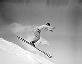 Man skiing, side view