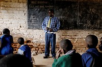 Zimbabwe, Mashonaland Central, Robert's Range. May 2010. Maori Primary School, a man teaching an AIDS Education class