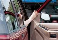 A woman´s foot propped on a car door in South Dakota, June 3, 2010