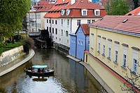 boat in Certovka Devil´s canal  In background water wheel of Great Prior´s Mill  In Kampa Island  Malá Strana quarter Prague  Czech Republic