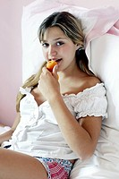 Girl eating apricot