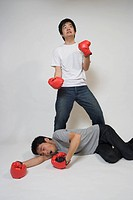 Two young men fighting