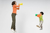 Mother and son shouting with megaphone