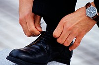 Close up of a man tying his shoe lace